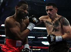  Brandon Rios lands a punch against Omri Lowther during their super lightweight bout at Cowboys Stadium on November 13, 2010.